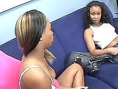black lesbians have fun with toys by sofa